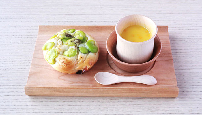 Bread and soup on the wooden bread board SENRO