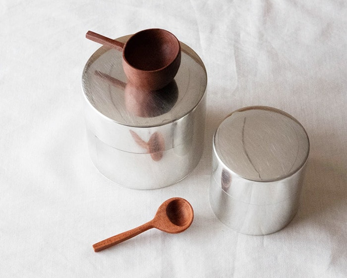 Tin tea caddies and wooden teaspoons