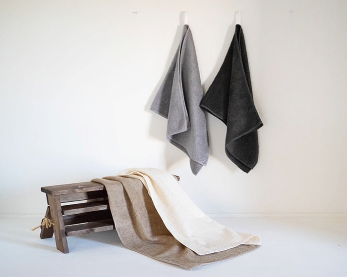 Organic cotton towels on the wall and rack