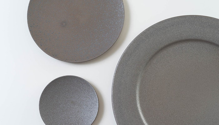 Different shades of colors of gray stoneware plates