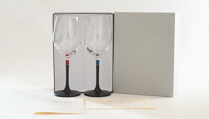 A pair of colored wine glasses in an exclusive box