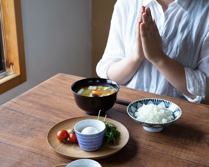 A woman is about to eat Japanese breakfast