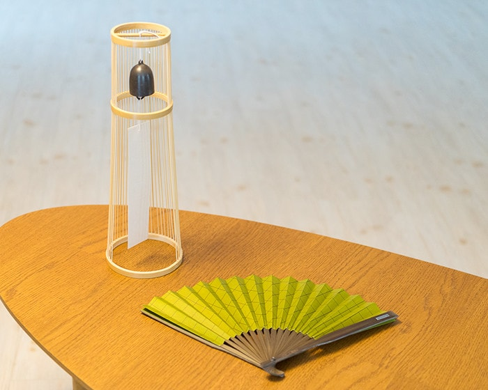 Tabletop wind bell and Japanese fan on the table