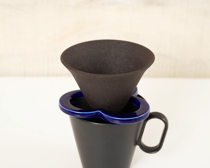 Ceramic pour over cone Caffe hat on black mug