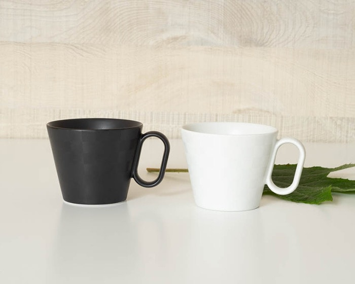 White and black Ichimatsu mugs from Wired Beans