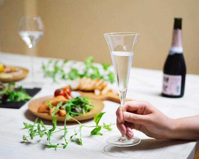 A woman has a sake glass KAORI with Japanese sake