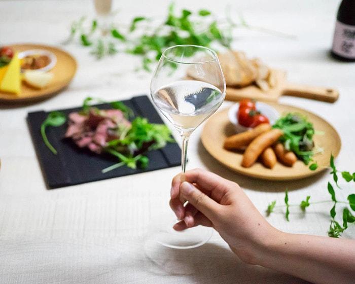 A woman has a sake glass KARAKUCHI with Japanese sake