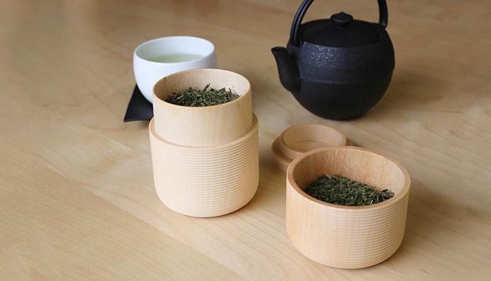 Green tea leaves in wooden tea canister Karmi
