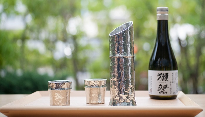 Bamboo sake set from Nousaku and Japanese sake Dassai