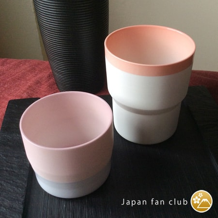 Two different size pink cups
