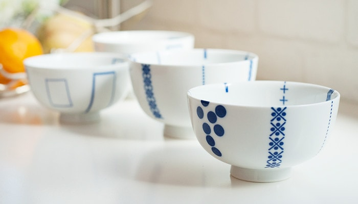 Deep blue painting look stand out on white porcelain of flower rice bowls