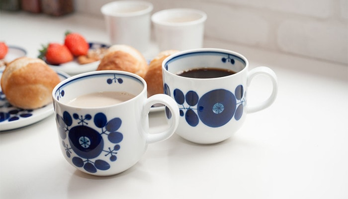 Coffee and café au lait in mugs of Bloom series
