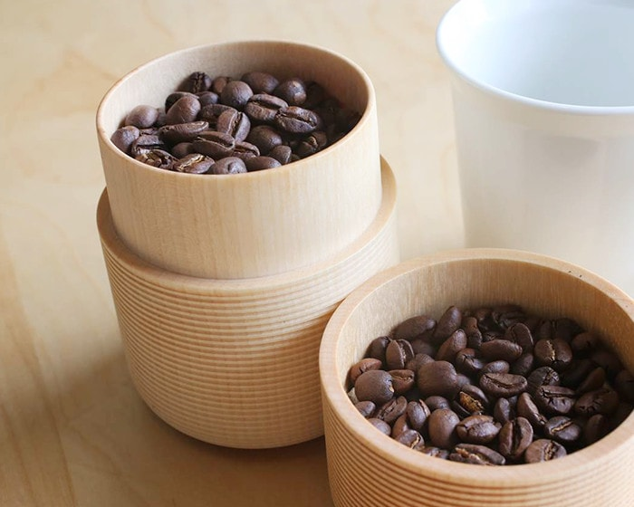 Coffee beans in wooden tea canister of Gato Mikio