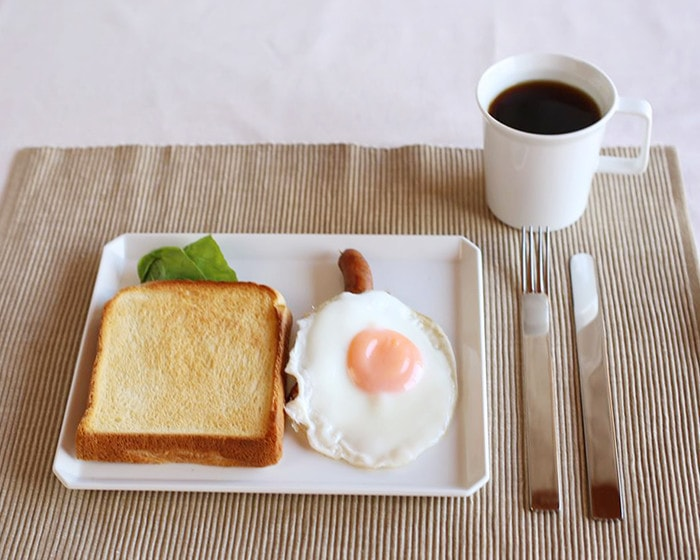 Toast and a sunny-side up egg on Square plate and a cup of coffee in mug from 1616/arita japan