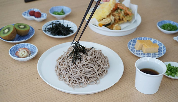 Eating Japanese soba with chopsticks