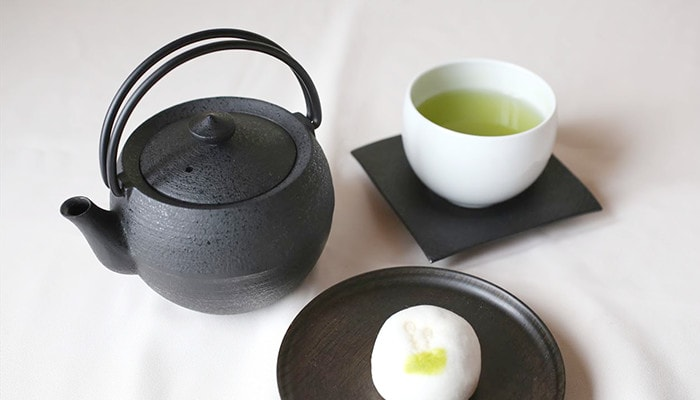 Teapot, teacup, with Japanese confectionery