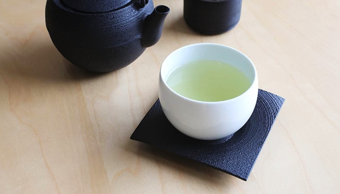 Japanese green tea in teacup on a saucer