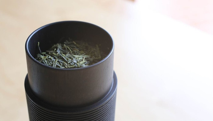 Japanese loose leaf tea in a wooden tea canister Karmi