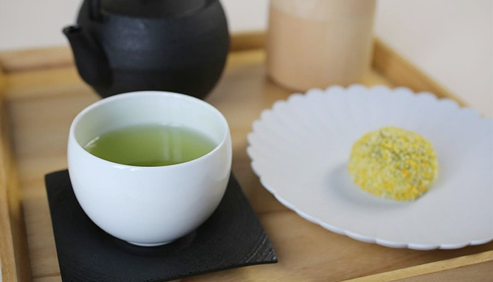 Japanese tea time with green tea in teacup and Japanese confectionery