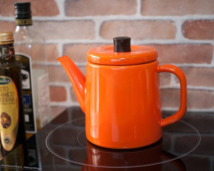 Orange Pottle on induction cooktop