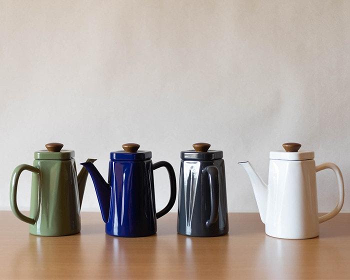 4 enamel tea kettles Anbi on the table