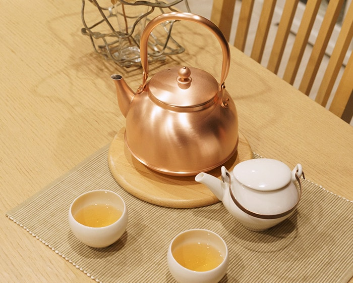 Copper kettle from Azmaya and tea set of sou sou on the table