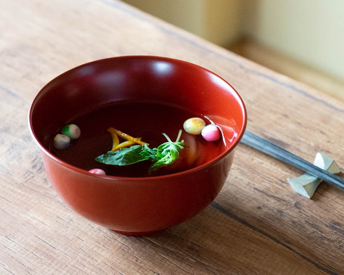 Beautiful gloss of Red Japanese lacquer bowl with broth soup