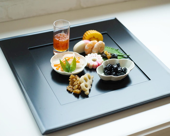 Tiny plates with Japanese food