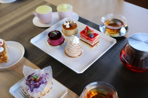 Tea time with pieces of cake on Square plates