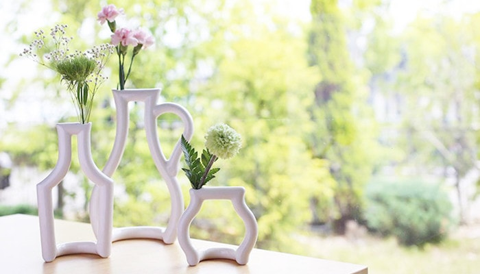 3 different bud vases still green with flowers