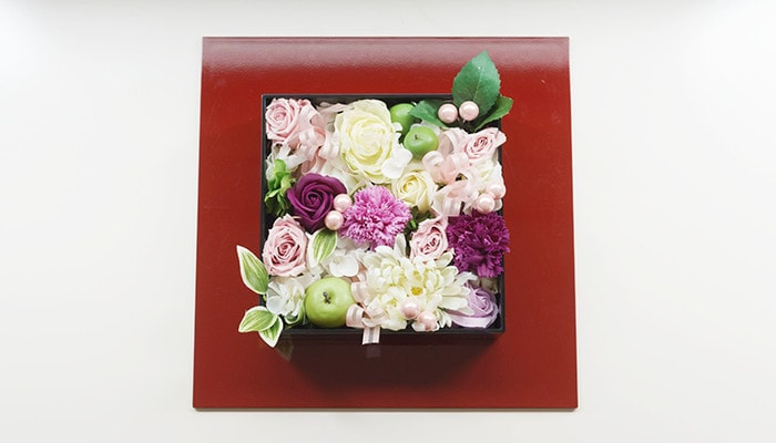 Jubako box filled with flowers on Oshiki