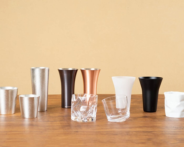 Various modern drinking glasses on the table