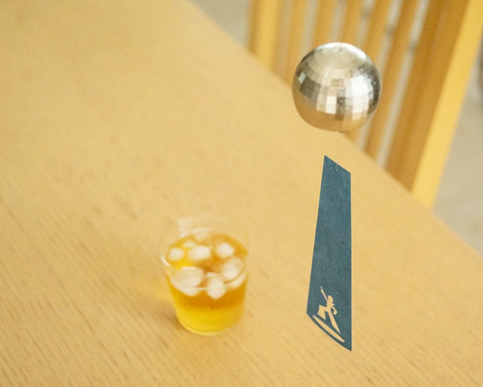 Disco ball wind chime from Nousaku above the table